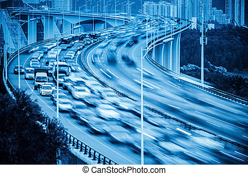 busy traffic and vehicles motion blur on the bridge