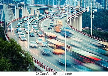 busy traffic closeup on curve bridge