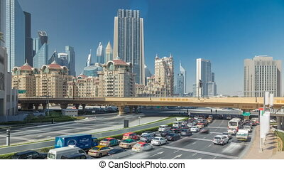 Busy traffic near Sheikh Zayed Road timelapse, modern skyscrapers around in luxury Dubai city