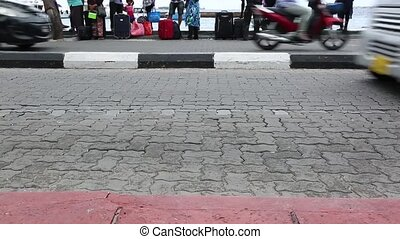 Busy traffic on city road of Male, Maldives. Cars, bicycles,...