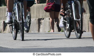 Busy Urban Path - Low angle shot of runners, cyclists, and...