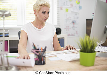 Busy woman focused on her work