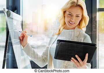 Busy woman using a board and a tablet