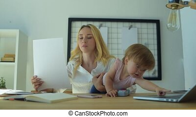 Busy woman working with documents at home