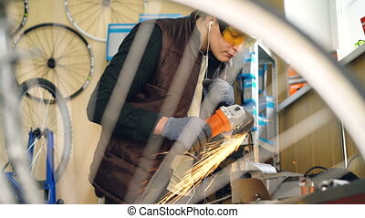 Busy young man skilled repairman is working with electric...