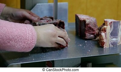 Butcher carving meat.