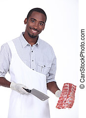 Butcher holding a rack of ribs