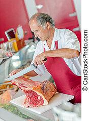Butcher preparing chops