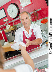 butcher serving customer