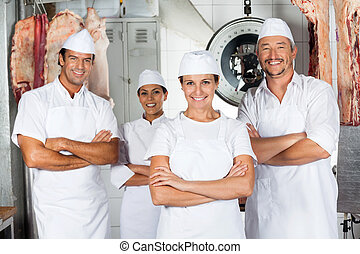 Butcher With Confident Team In Butchery - Portrait of mature...