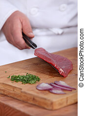 Butcher with raw piece of piece
