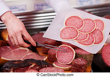 Butcher's Hands Packing Meat In Paper At Shop - Closeup of ...