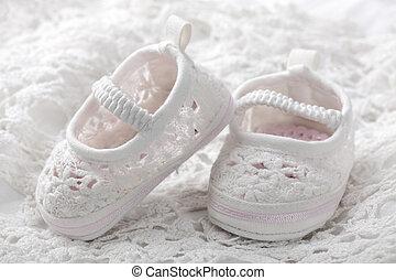 butins bébé, blanc
