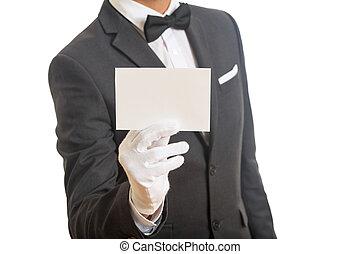 Butler holding a blank card