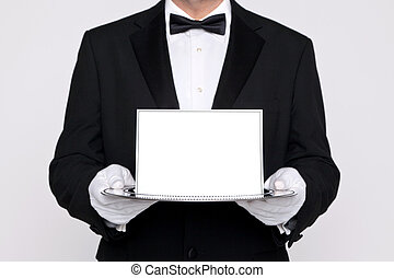 Butler holding a blank card upon a silver tray