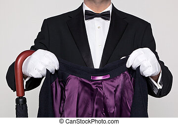 Butler holding your coat and umbrella. - A butler holding a...