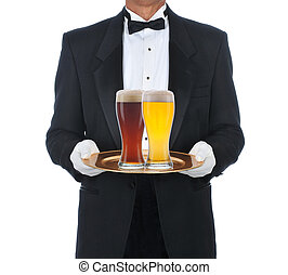 Butler Wearing Tuxedo Holding Tray with two full beer...