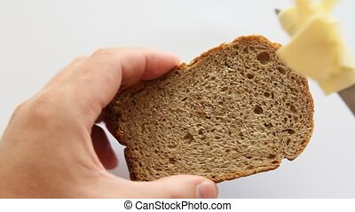 Butter being spread on a  toast