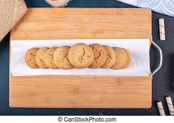 Butter biscuits on a wooden board. Top view