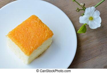 butter cake topping golden egg strips on dish