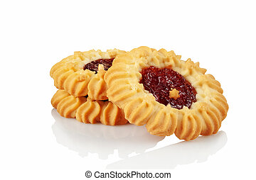 Butter cookies, tartlet with strawberry jam on a white ...