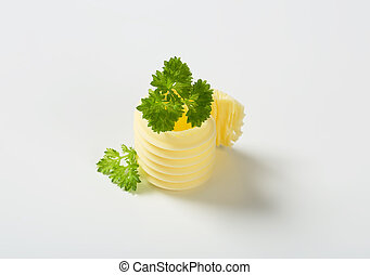 butter curl with parsley on white background