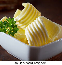 Butter curls for restaurant advertising in a bowl cold and...
