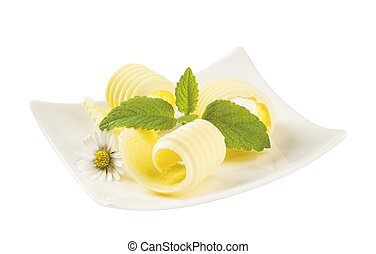Butter curls on a small porcelain plate