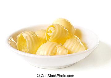 Butter Dish - A dish of butter curls.