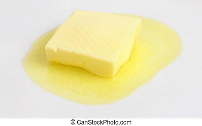 Butter - Melting butter on a plate