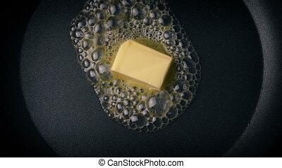 Butter Melting In Frying Pan Overhead Shot