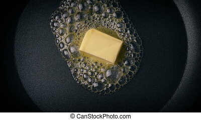 Butter Melting In Frying Pan Overhead Shot - Overhead shot...