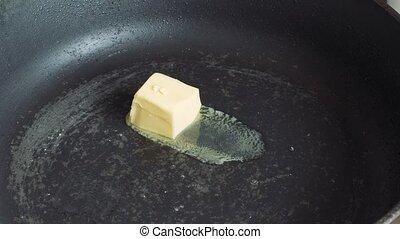 butter melts in a hot pan.