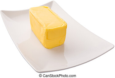 Butter Over White Background - Butter on a white plate over...
