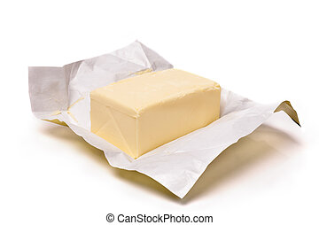 Butter - Piece of butter in paper on a white background. ...