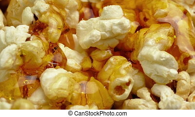 Butter Sauce Pours On Popcorn - Butter sauce poured on...