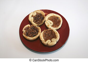 Butter Tarts on a plate.