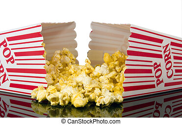 buttered theater popcorn - buttered popcorn spilling out of...