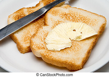 Buttered Toast - A pat of butter on freshly made toast.