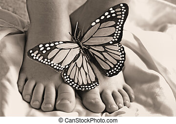 butterflies and toes - butterfly on childs feet.
