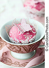 Embossed butterfly cupcake in an old fashioned teacup