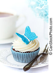 Butterfly cupcake - Cupcake decorated with a blue sugar...