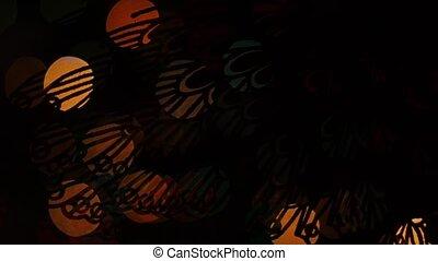 Butterfly lights bokeh on black background. Shape