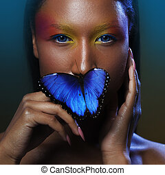 Butterfly on the lips, Young and beautiful black model exotic look