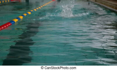 Swimmer performing the butterfly stroke