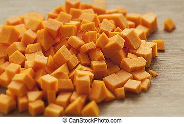 Butternut Squash Cubes - Chopped orange butternut squash on...