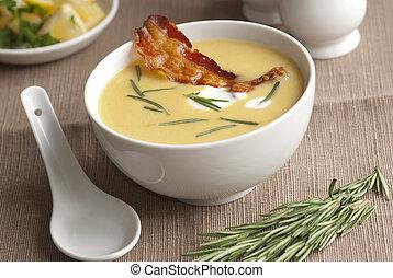 Butternut squash soup with crispy prosciutto in a bowl