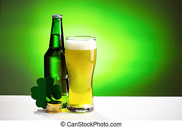 Buttle and glass of fresh cold beer. Concept for St. Patrick's day.