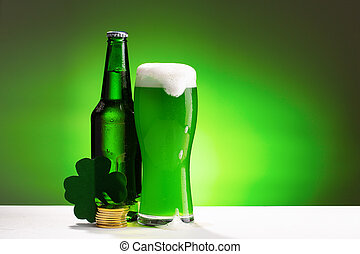 Buttle and glass of fresh green cold beer. Concept for St. Patrick's day.