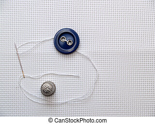 Button, needle, thimble